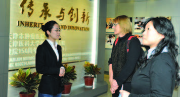 Hildegund C. J. Ertl, M.D., (second from R) and her laboratory's project manager, Emily Liu (R).