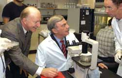 Sam Donaldson with Meenhard Herlyn (L) in the lab.